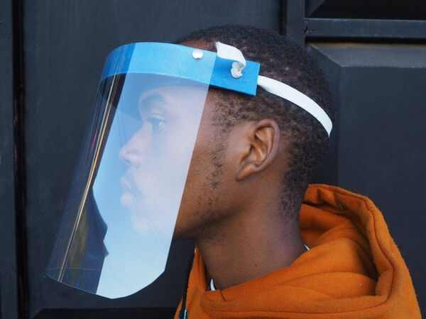 Bahati with the face shield